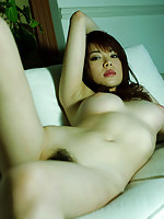 Inticing asian babe sizzles with her plump tits and high heels