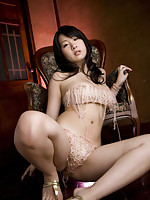 Sensual gravure idol beauty showing off her curves in lingerie