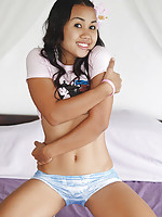 Shy Asian teen in cute pink t-shirt lifts petite panties