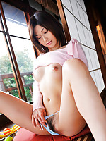 Gorgeous gravure idol babe lifts her sweater to show naked tits