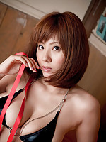 Delicious gravure idol babe playfully ties herself up with ribbon