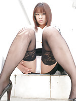 Naughty asian secretary shows her white panties and stockings