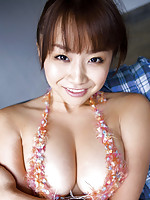Incredibly busty gravure idol in her sexy leather lingerie