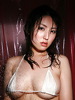 Sensuous asian model with big busty boobs in lace lingerie