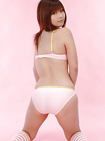 Adorable gravure idol posing in her lingerie and stripped socks
