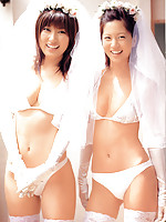 Two stacked and flirtatious gravure idol babes in white lingerie