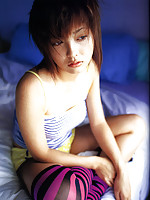 Beautiful gravure idols big brown eyes allures and intices
