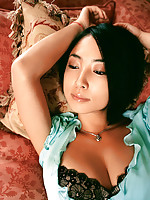 Cute, petite asian model wearing slinky little dresses to tease