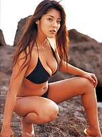 Thick asian hotty with plump voluptuous breasts in a bikini