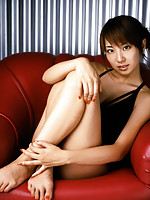Cute gravure idol with a perfect figure in a little white dress