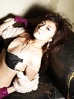 Mouth watering asian vixen entices with wild hair and lingerie