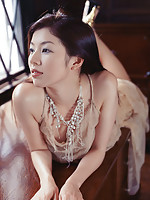 Sultry asian babe taunts and teases in her short skimpy dresses