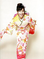 Beautiful gravure idol dressed in a bright and colorful kimono
