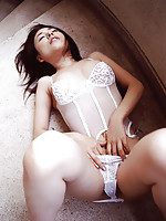 Sexy asian idol stripes off her lace lingerie to display her body
