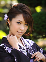 Naked asian beauty shows off her plump petite boobs in a kimono
