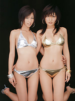 Two alluring gravure idol beauties showing off in their bikini