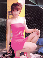 Sexy asian diva poses in a sizzling skin tight hot pink dress