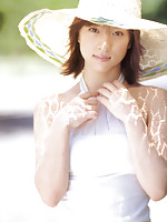 Alluring asian angel is mesmerizing in her white and yellow dress