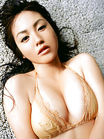 Steamy gravure idol hottie displays her big busty boobs in bikini