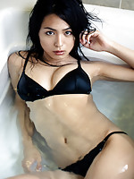 Sultry gravure angel laying around in bed in her sexy lingerie