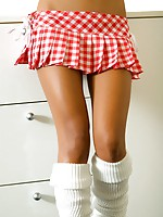 Thainee posing nude in a very cute mini skirt