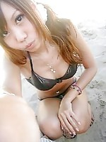 Chinese girls looking sexy in their beach bikinis