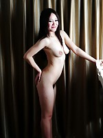 Chinese girl with long hair taking naked pictures