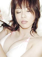 Enchanting and gorgeous gravure idol laying around in lingerie