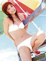 Sultry gravure model seduces with her hot red leather bikini