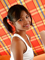 Petite teenager Tussinee in pigtails posing in a wet t-shirt