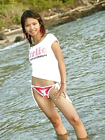 Tiny teen Thai girl takes a swim in the Gulf of Thailand