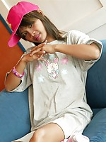 Teen Thai girl Tussinee in her pajamas and pink cap