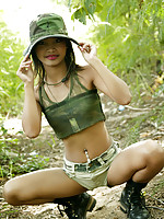 Petite Thai teen in full Army apparel and ready for duty