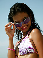 Asian teen model at the beach poses on a Jet Ski