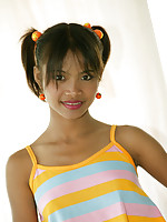 Adorable pigtail Thai teen shows off her colorful dress and pretty white panties
