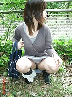Japanese girlfriend loves to flash her hairy pussy outdoors