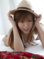 Super hot Japanese girl getting naked on the bed