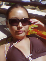 Hot Thai girlfriend looking very stylish with her sun glasses