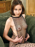Asian girl in seductive fishnet gear