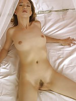 Slender and absolutely exposed Japanese female on her bed