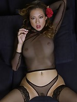 Oriental female fully wrapped in nylon body suits exposes herself