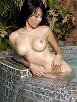 Wet shapely asian model
