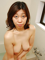 Japanese granny takes cock in mouth and pussy