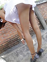 Sexy Thai girl flashing her tits and upskirt panties in public