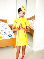 Super sexy stewardess Tussinee strips and does a nude split