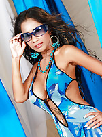 Hot DD model poses and strips from her blue outfit to reveal her massive tits