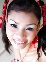Pigtail Thai beauty strips to show off her tiny little pussy