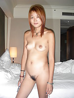 sleeky japanese ho with reddish hair lies naked