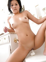 Lin shows her perfect body and pleasures her hairless pussy to orgasm in her bathroom
