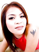 Cute little Thai babe Dar strips and teases out of her hot red dress